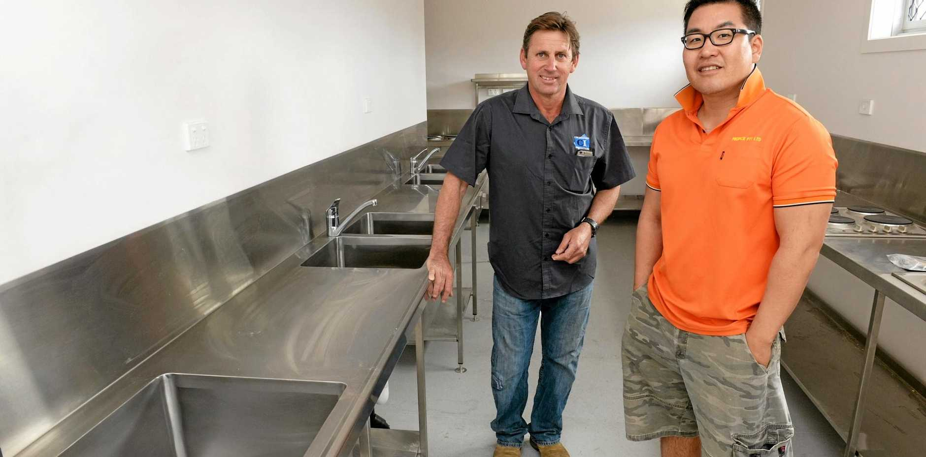 NEW PREMISES: Tony Giovannoni with James Lee at the new Tomato Backpackers.