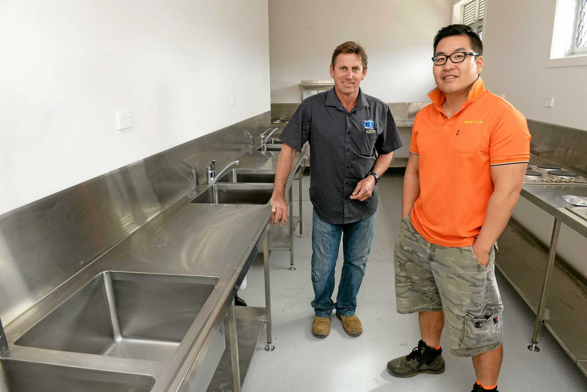 NEW PREMISES: Tony Giovannoni with James Lee at the opening of Tomato Backpackers.