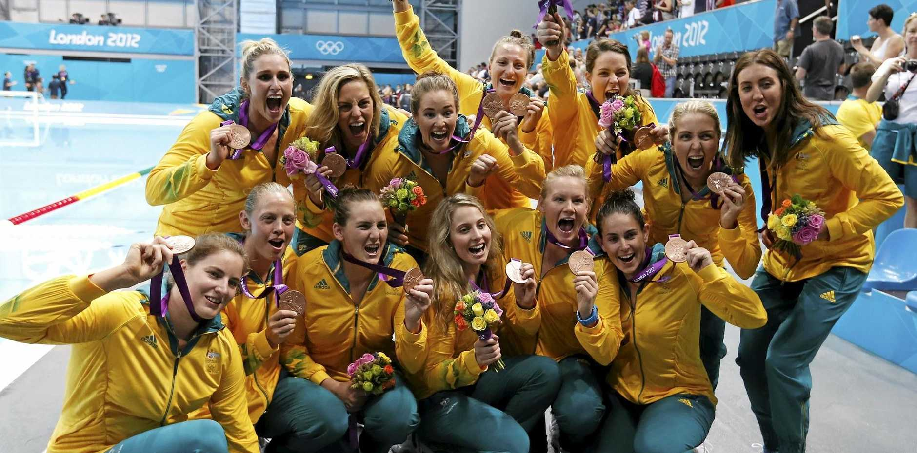 FLASHBACK: Members of the Australian women's water polo team pose for the camera with their bronze medals following the medal ceremony at the 2012 London Olympics.