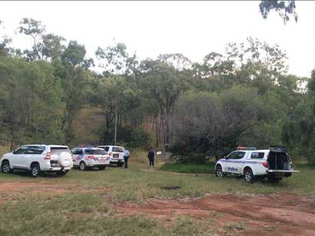 A police chopper is searching for a missing woman at Mt Larcom.