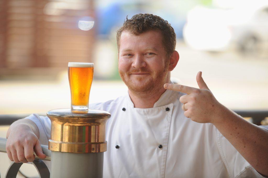 Gavan Chin raises his glass of Fat Yak on International Beer Day.