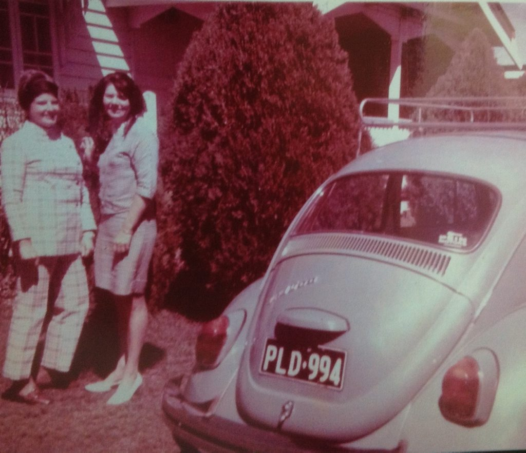 Molly and a friend beside her favourite car, the Volkswagen, visiting her mother at 38 Hurst St.