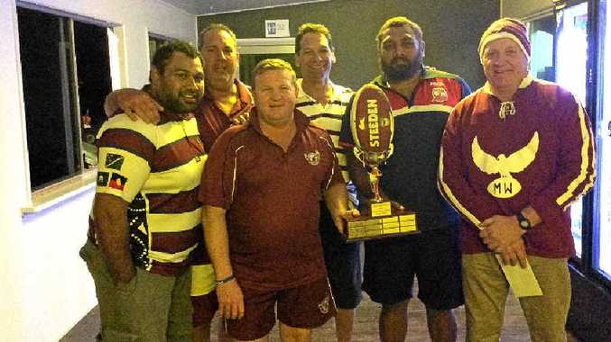 The winning Manly Team John Kelleher holds the trophy with teammates Neil Leach, Josh Fatnowna, Eddie Ramsamy, Issac Fatnowna and John Wotherspoon.