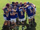 TEAM EFFORT: The Junior Wheatmen Under 11 team huddle up before the big game.