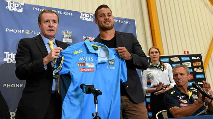 HUGE COUP: Titans CEO Graham Annesley presents Jarryd Hayne with a Titans jersey as coach Neil Henry looks on.