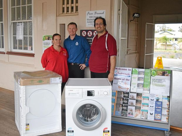 GENEROUS DONATION: Rayleane Griffiths, Justin Lanson and Jason Vella with the washer and dryer donated to WDOP by The Good Guys.