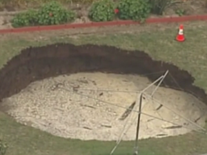 Sinkhole is swallowing back yard