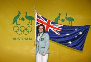 MELBOURNE, AUSTRALIA - JULY 06: Anna Meares poses with the Australian flag during the Australian Olympic Games flag bearer announcement at Federation Square on July 6, 2016 in Melbourne, Australia. (Photo by Scott Barbour/Getty Images)