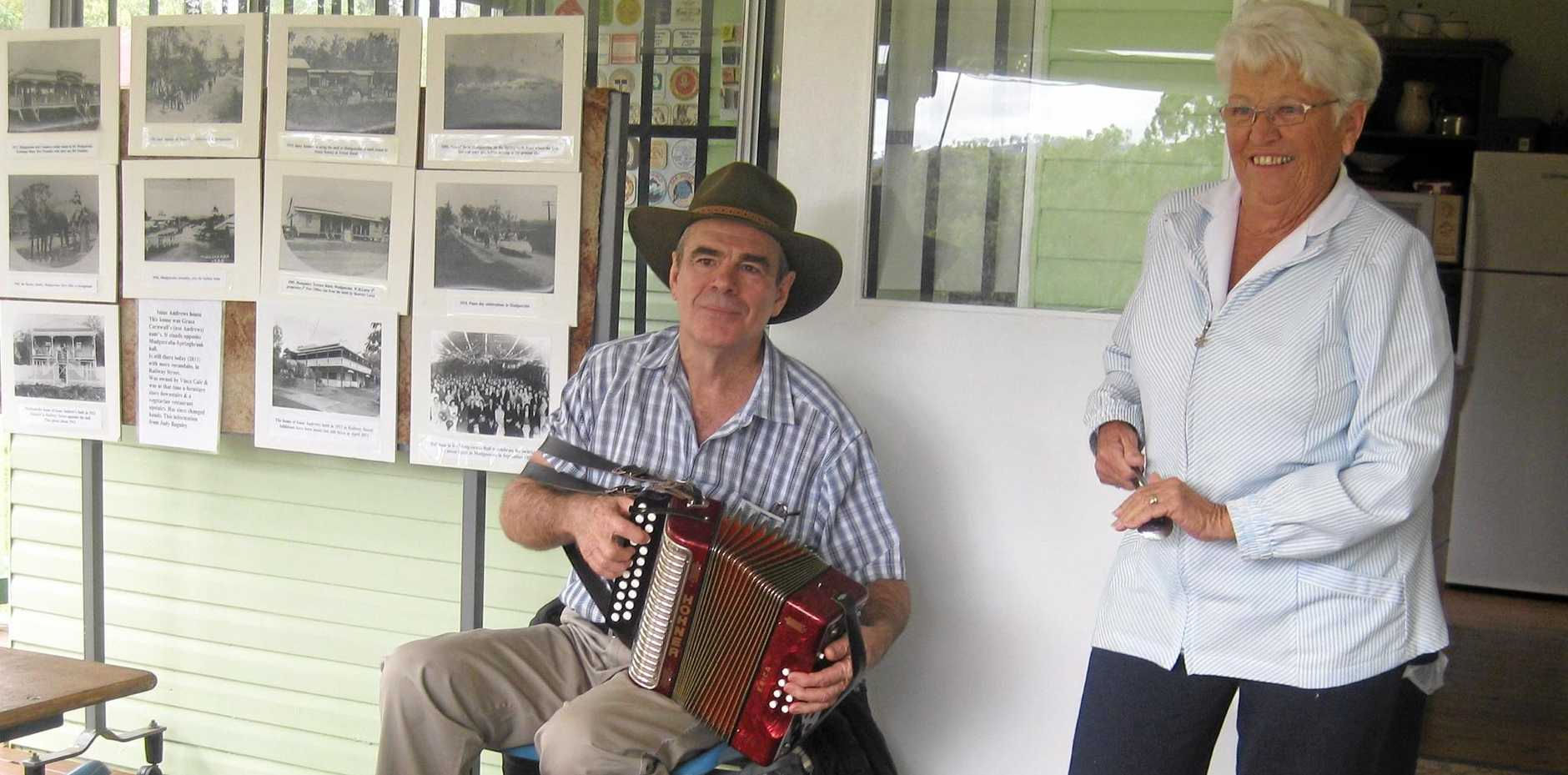 HISTORIC DISPLAY: An accordion player accompanies a visitor playing the spoons at the Gold Coast Hinterland Heritage Museum.
