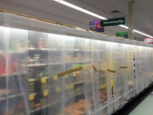 Why were this Coast supermarket's shelves stripped?