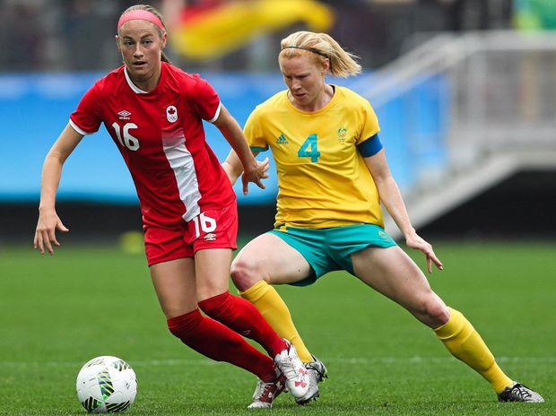 Janine Beckie (left) of Canada and Clare Polkinghorne in action during the match between Canada and Australia.