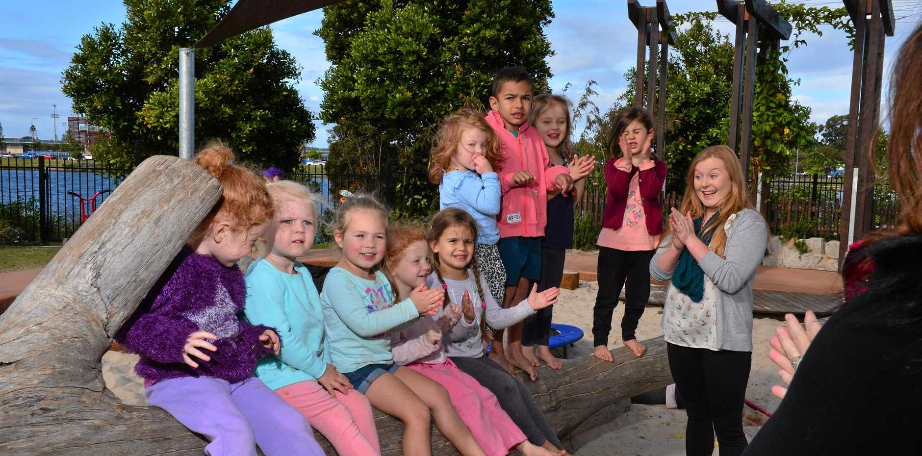 IN DEMAND: Green Beginnings Child Centre teacher Lucy Bauer plays with (from left) Jayda Smith, Everley Walsh, Myla Eacersall, Demmi Smith, Shelby Harrison, Paige Davidson, John Garnsey, Lyla Irvine and Eiliyah Shaich-Yusuf.
