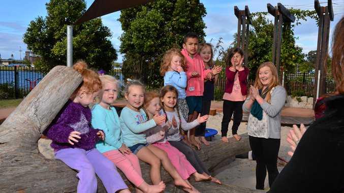 IN DEMAND: Green Beginnings Child Centre teacher Lucy Bauer plays with (from left) Jayda Smith, Everley Walsh, Myla Eacersall, Demmi Smith, Shelby Harrison, Paige Davidson, John Garnsey, Lyla Irvine and Eiliyah Shaich-Yusuf.