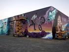 Giant mural celebrates future development.