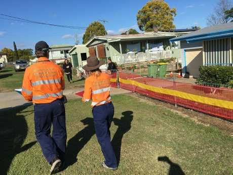 Officers from the Environment Heritage and Protection Department at the property to inspect the sinkhole.
