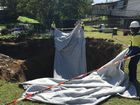 UPDATED: Boulders, special fabric dropped into sinkhole