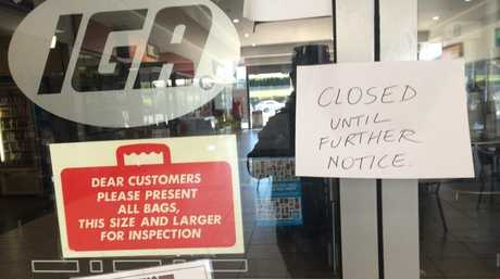 The note informing customers the door of the IGA on Bridge St.