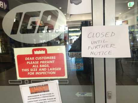 The note informing customers the door of the IGA on Bridge St.