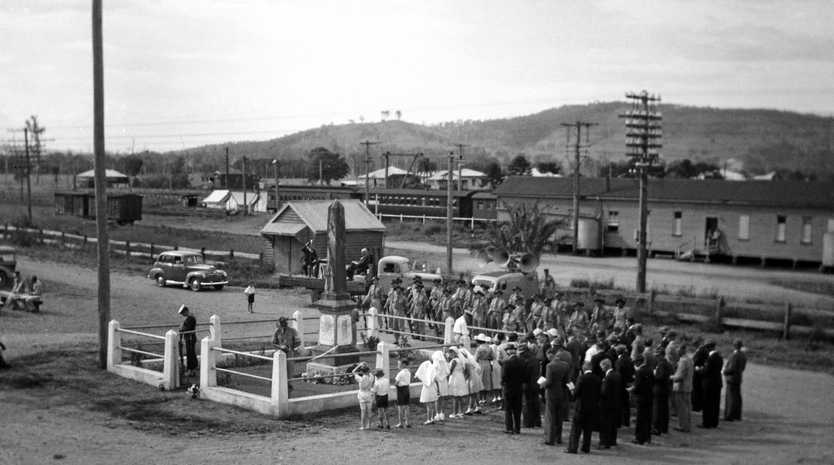 Anzac Day service at the War Memorial, Yandina, 1940s. The sandstone and granite memorial was unveiled by Senator Major General Sir William Glasgow on 7 June 1924.