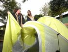 TENTS GALORE: Sarah Walker with Bianca Zingus and one of the Splendour tents that was salvaged.
