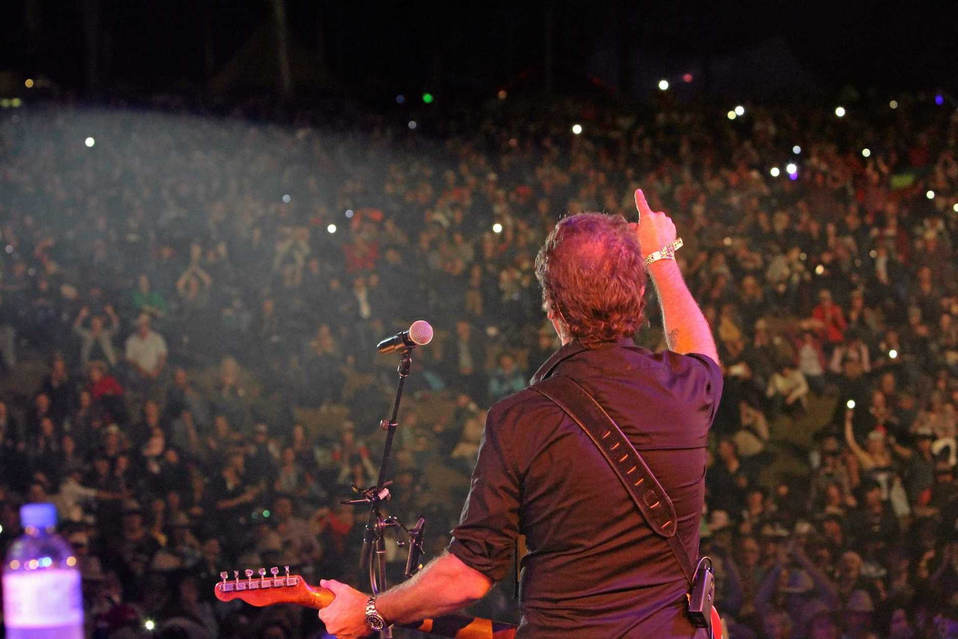 Troy Cassar-Daley had all the lights on the hill in his tribute to Slim Dusty at the 2015 Gympie music muster Photo Jason Dougherty / Gympie Times