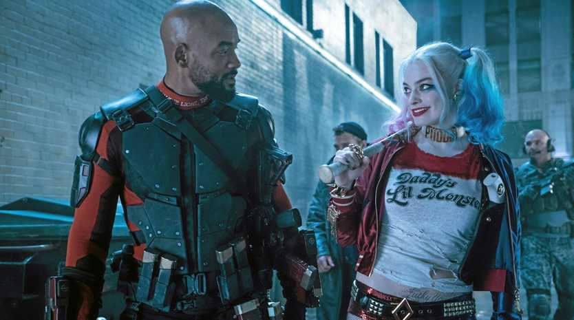 FOR REVIEW AND PREVIEW PURPOSES ONLY. Will Smith and Margot Robbie in a scene from the movie Suicide Squad. Supplied by Warner Bros.