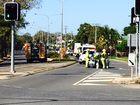 Police close a Gladstone Street's lane after cars crash