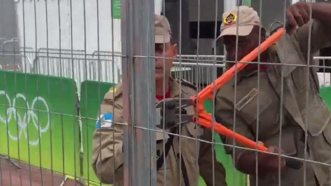 Fireman reportedly had to break open one of the main gates to the main Olympic stadium in Rio de Janeiro because the key went missing. Picture: Julia Carneiro/Twitter