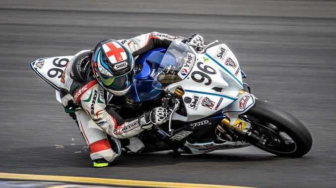 GROUND LEVEL: James Creek Supersport rider Luke Mitchell throws up sparks as he gets low around a corner.