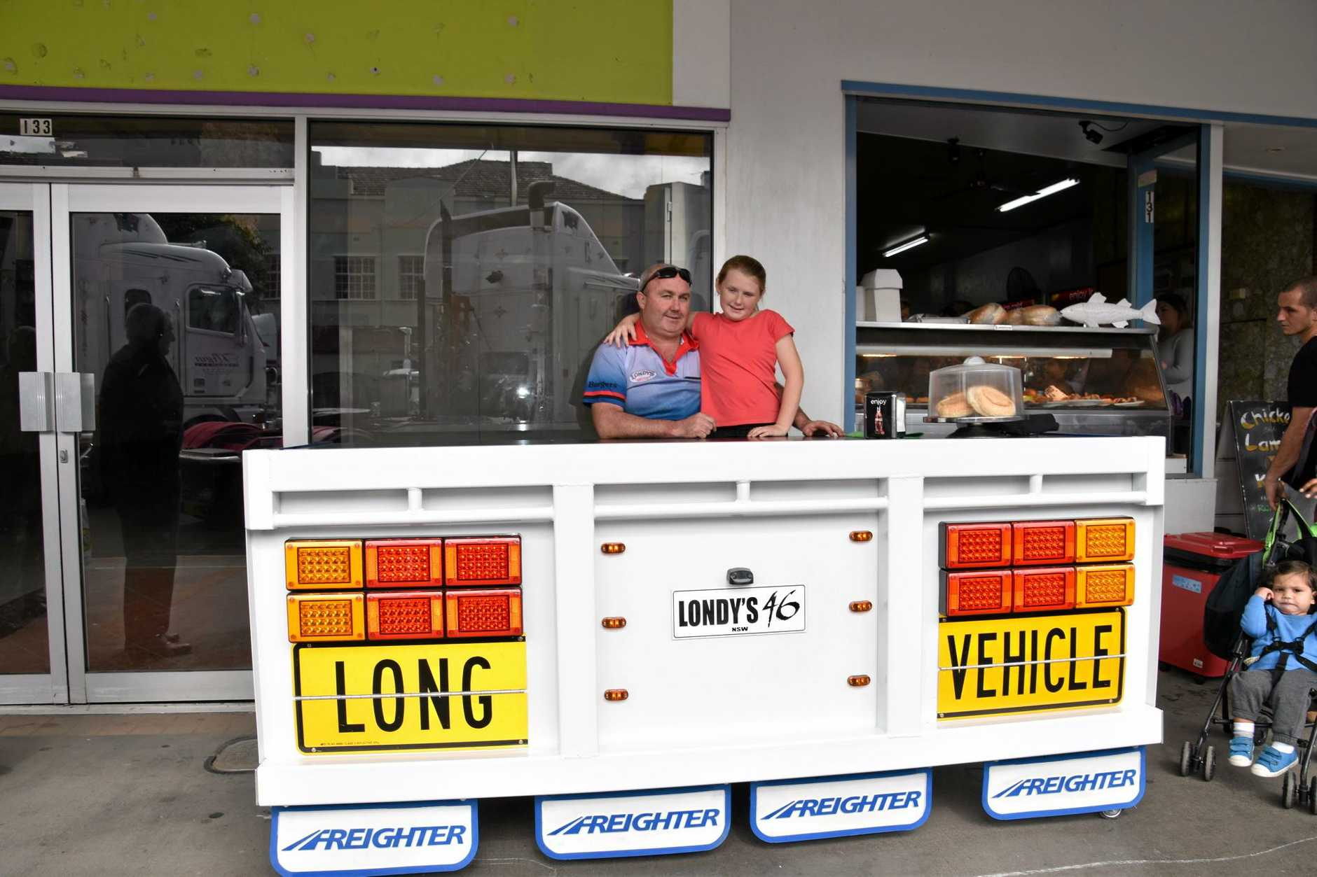 Local Casino business Londy's got into the spirit of the Casino Truck Show with this truck rear end table. Jason O'Reilly and daughter Eliza, 9 sit and enjoy the day.