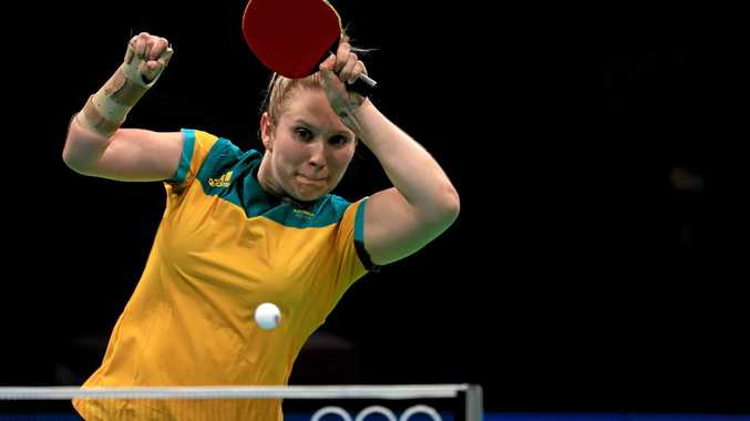 Melissa Tapper of Australia plays a women's singles preliminary match against Caroline Kumahara of Brazil.