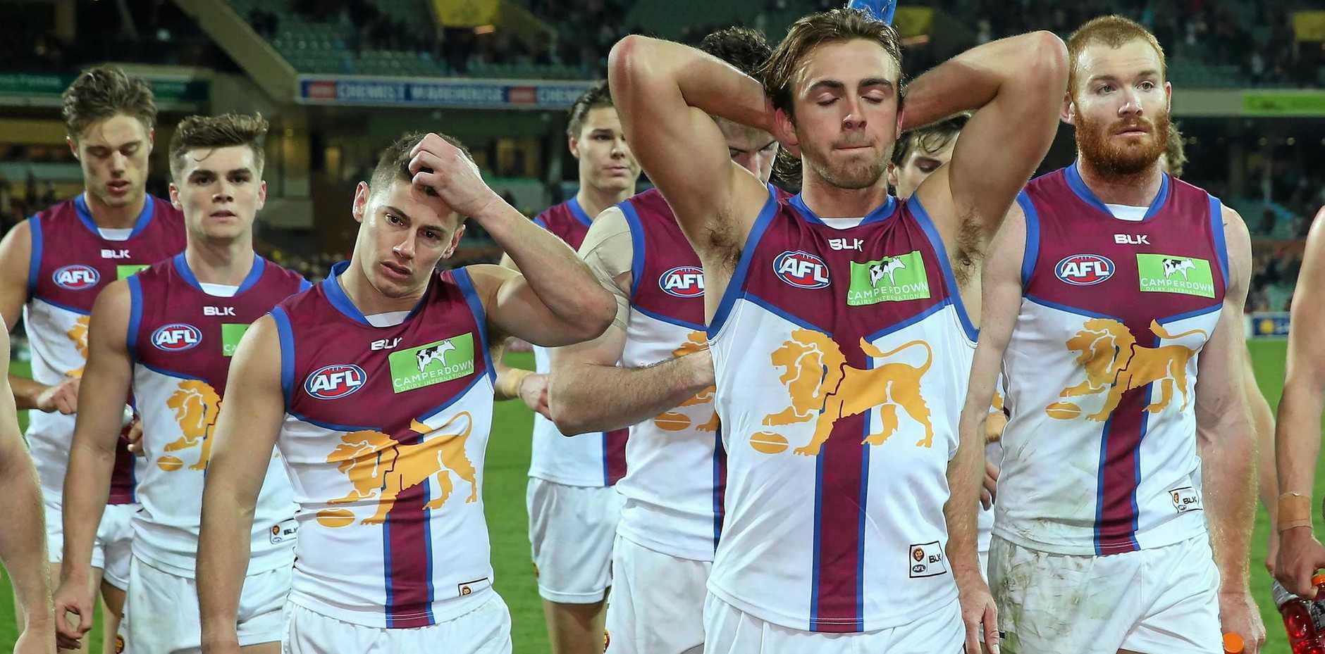 No answers, Lions players leave Adelaide Oval after their team lost to the Crows.