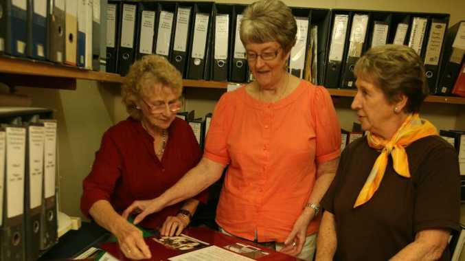 Mackay Family History Society's Carolan Hill, Yvonne Peberdy and Judy Wallace prepare for their 'Pioneers of Mackay' Exhibition. Photo Lee Constable / Daily Mercury