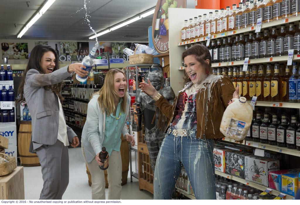 Mila Kunis, Kristen Bell, and Kathryn Hahn in a scene from the movie Bad Moms.