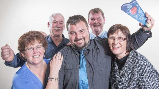 Nathan Benn (centre) celebrates with his staff after Benny's Smash repairs was named as Business of the Year at the 2016 Clarence Valley Business Awards