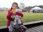 FRIENDLY FACES: Ember Martin, 14 months, and mum Sophia Williams meet Rexie the Dinosaur at Condy Park's Teddy Bears' Picnic on Sunday.