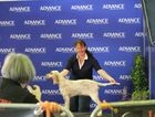 Fraser Coast's Jasinta Chapman and Lacey pose for canine photography expert Ingrid Matschke at the Ekka. Photo Sherele Moody / APN NewsDesk