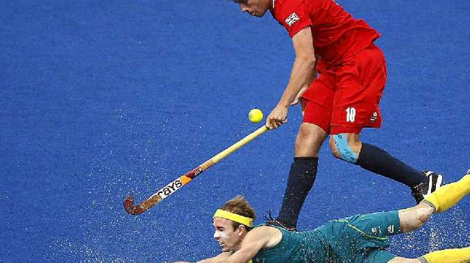 Mackay's Matt Swann makes a daring slide during the men's field hockey bronze medal match at the London Olympics where Australia won 3-1.