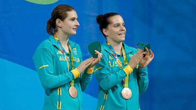 Bronze medalists Maddison Keeney and Anabelle Smith of Australia pose on the podium.