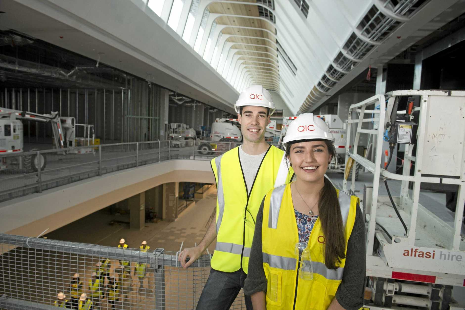 John Poole and Georgia Glanville were part of a group of TAFE Queensland South West students given a tour of the Grand Central redevelopment, Monday, August 8, 2016.
