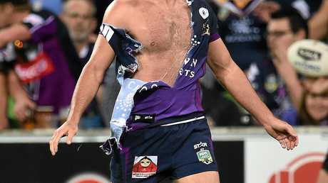 GRAPPLE: Melbourne Storm's Cameron Smith with a shredded jersey. No doubt he'd deny it coming from any sort of grappling in the ruck.
