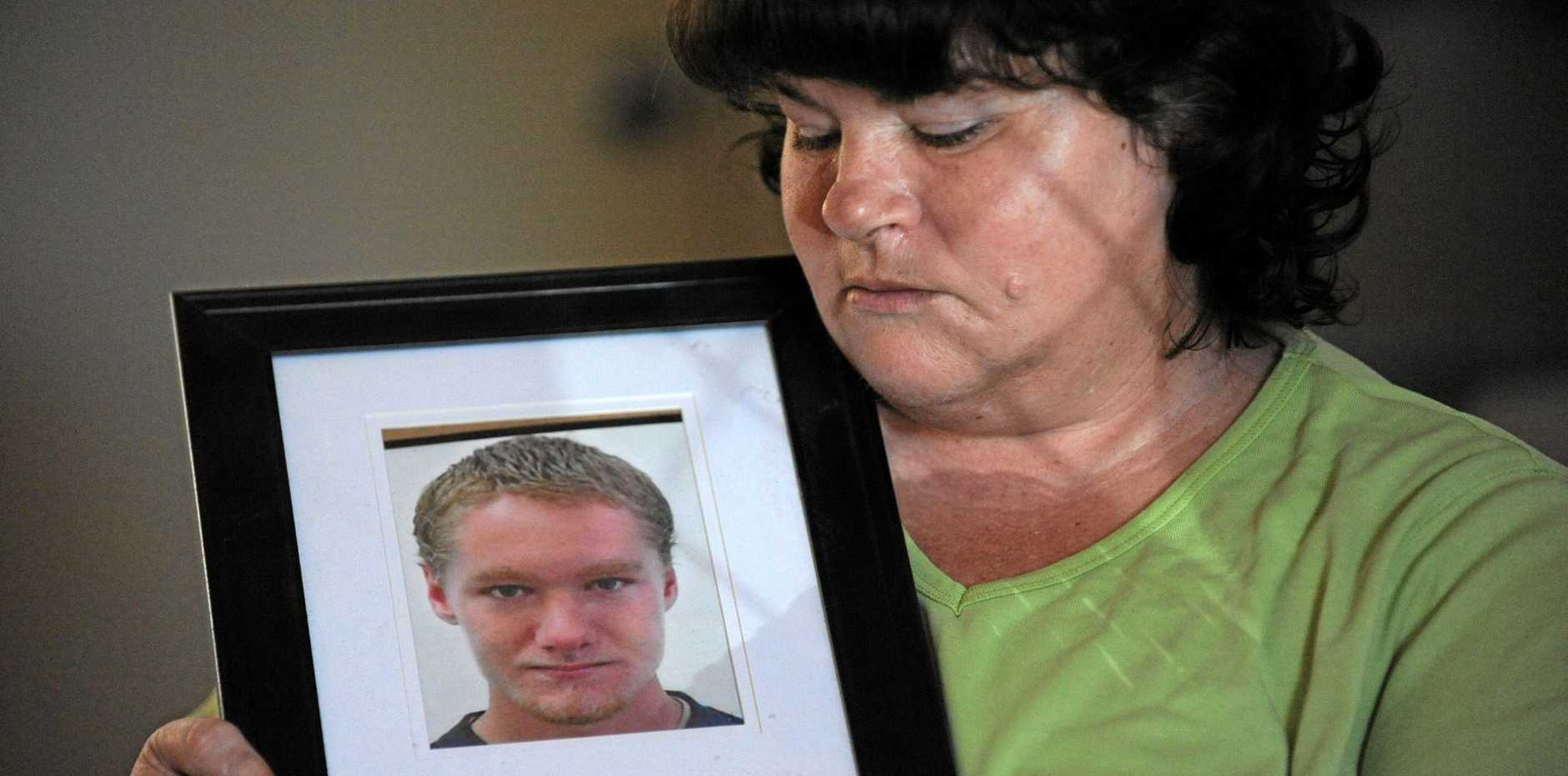 GRIEVING MOTHER: Helen Gordon with a portrait of her son Leonard Gordon who was murdered at the Maryborough Correctional Centre in 2012. Photo: Mike Knott / NewsMail
