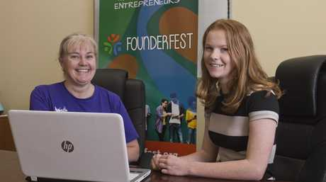 Canvas Coworking's Joy Taylor (left) chats with Mikeala Ridley about the inaugural Founderfest 2016 - Igniting Young Entrepreneurs, Tuesday, April 19, 2016.