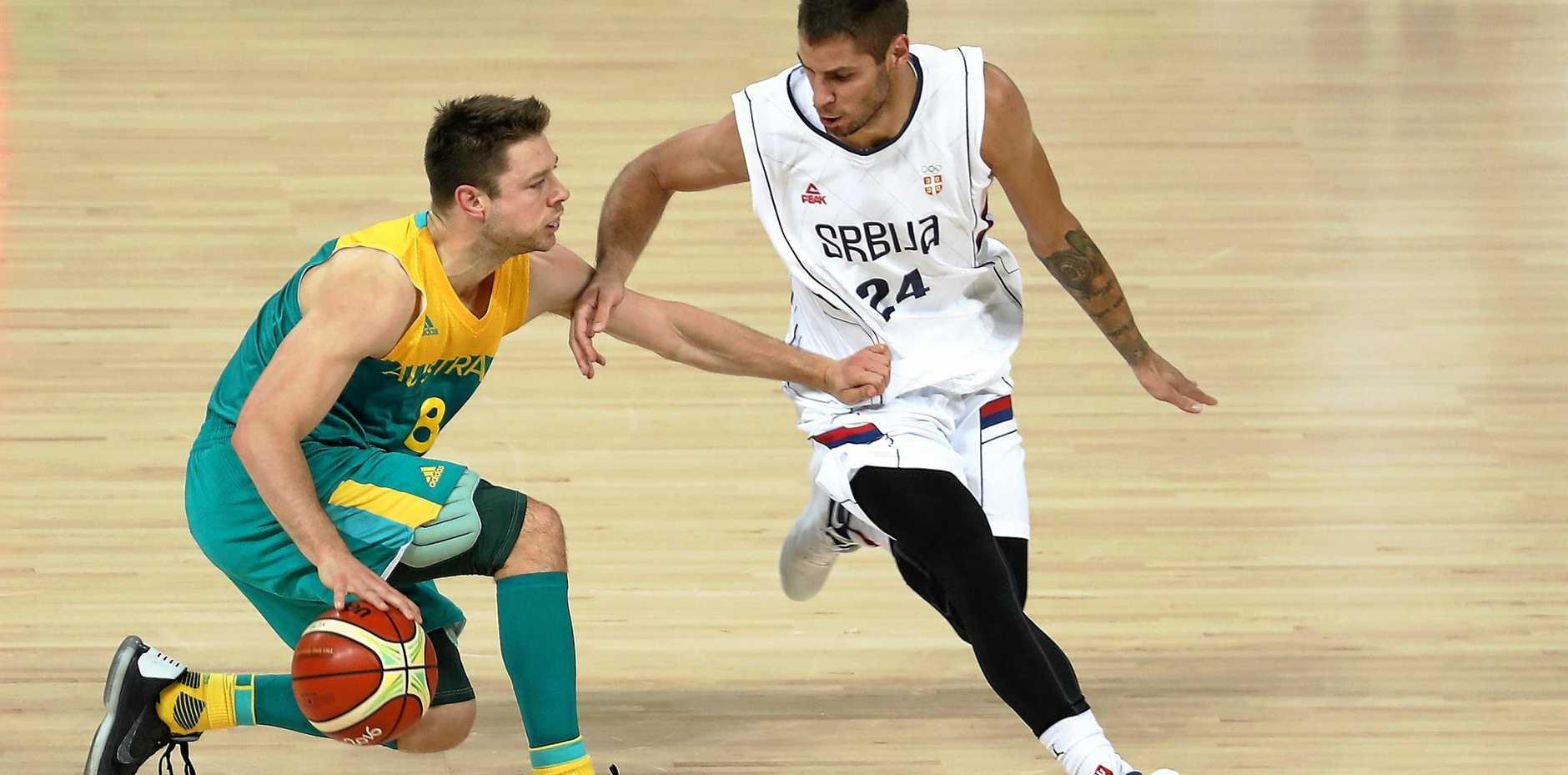 Matthew Dellavedova dribbles against Stefan Jovic of Serbia.