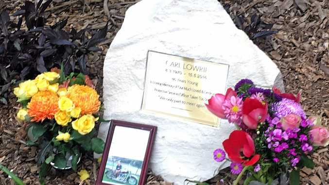 Gympie Hospital staff unveiled a memorial plaque for security guard Carl Lowrie who died on the job in May 2016.