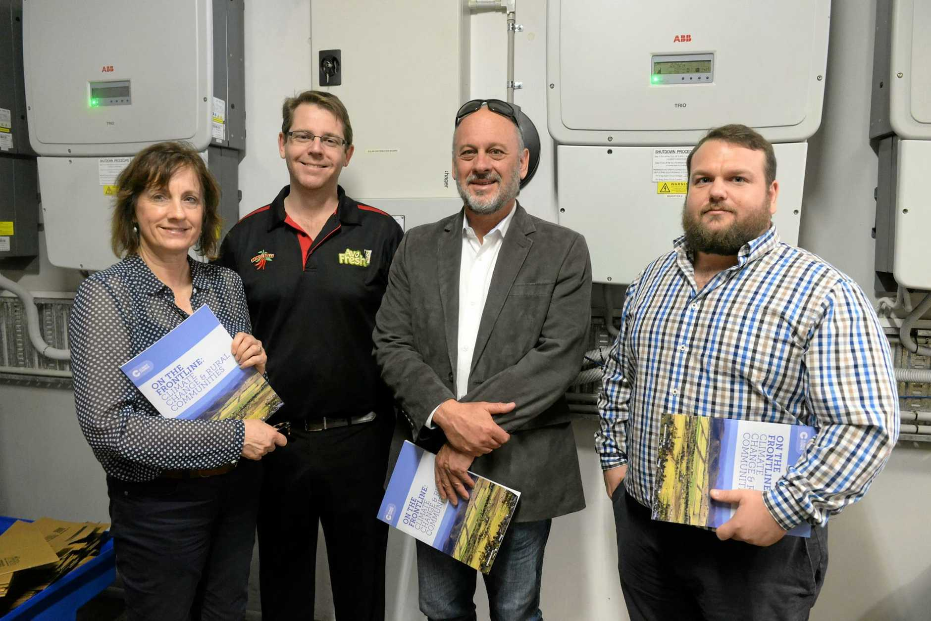 RENEWABLE ENERGY: Lesley Hughes, Austchillis Trent De Paoli, Tim Flannery and GEM Energys Jack Hooper at Austchilli.