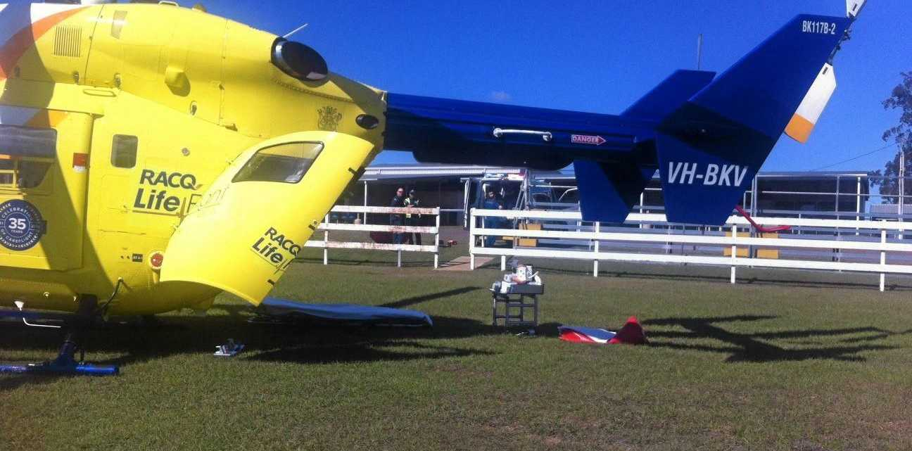 RESCUE FLIGHT: Lifeflight officers prepare to transport a woman to Brisbane after she was hit by a truck this morning at Blackbutt. She suffered serious head injuries.