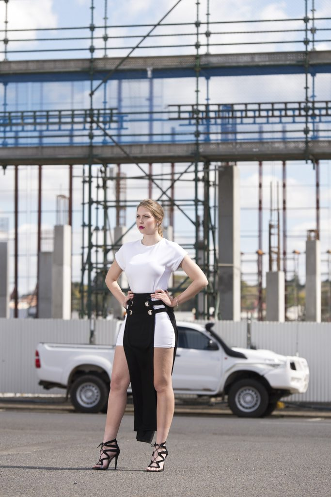 Cara Gilligan models clothes from Ophelia Boutique.