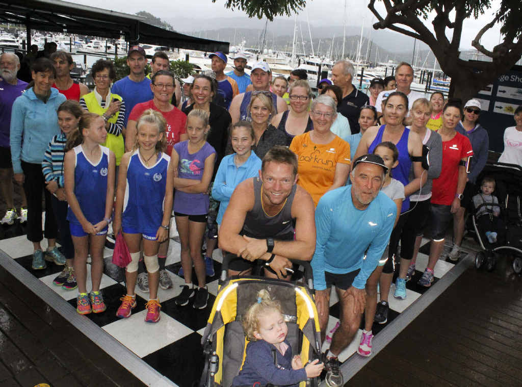FUN RUN: President of the Whitsunday Running Club Tim Oberg with local Whitsunday runners ready for the Airlie Beach Race Week Family Fun Run.