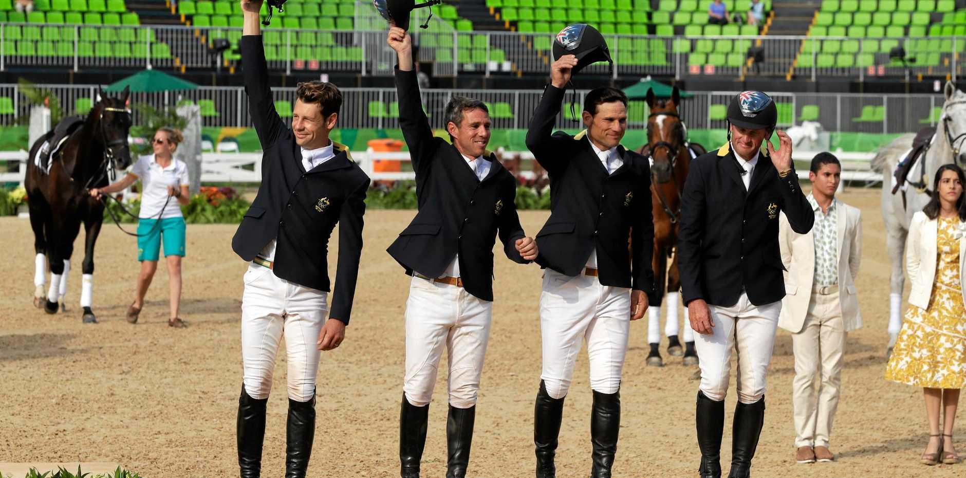 Shane Rose, Stuart Tinney, Sam Griffiths and Christopher Burton of Australia celebrate winning a bronze in Rio.